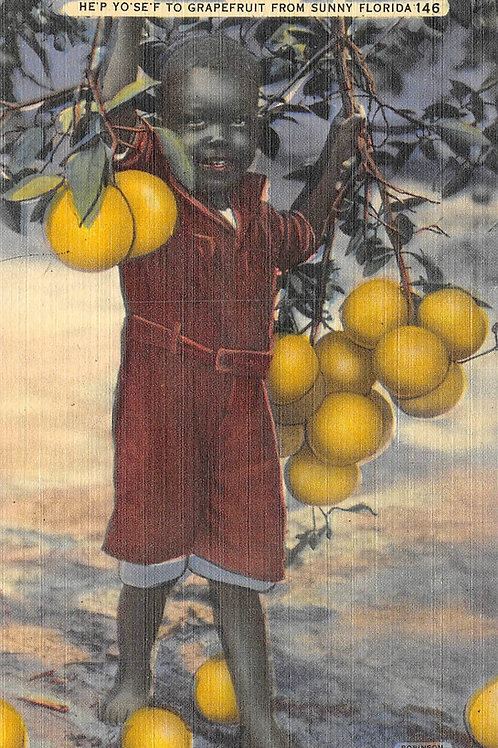 Boy with grapefruit bunches