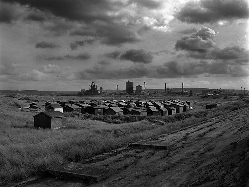 Black and white photograph of the green huts, South Gare, Redcar.