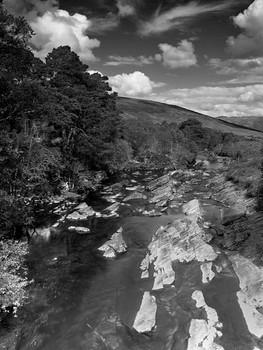 A river runs through it.. Plocton Scotland