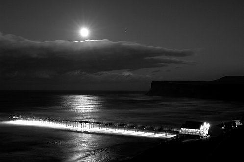 Black and white print of Saltburn by the Sea pier at night.