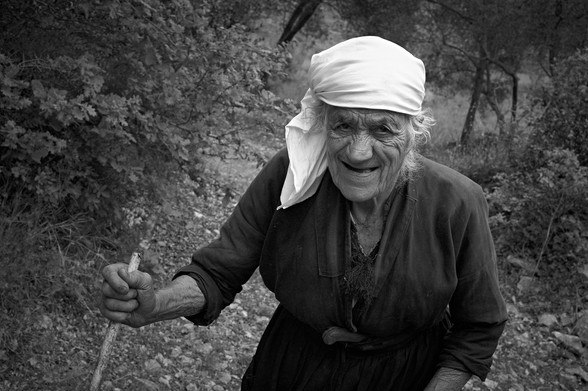 Portrait of a woman fininising her work on the land