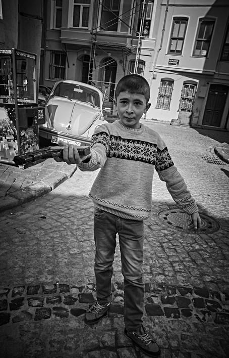 A boy with a gun in Ballet, Istanbul