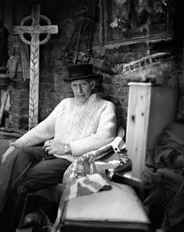 Portrait of artist Tommy in his Studio