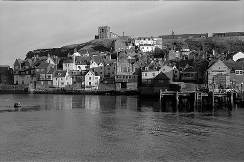 Black and white photograph of Whitby Old Town and Whitby Abbey.