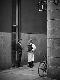 Street photography of a chef talking to
