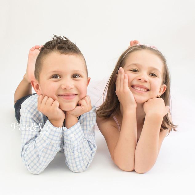 siblings-brother-sister-posing-smiling.j