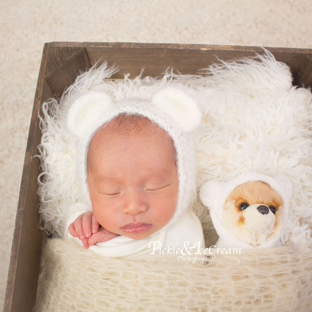 sleeping-newborn-baby-basket-teddy.jpg