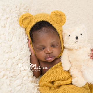 newborn-baby-hugging-teddy-bear.jpg