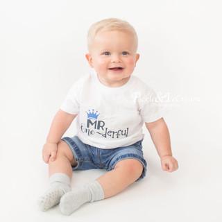six-month-baby-boy-sitting.jpg