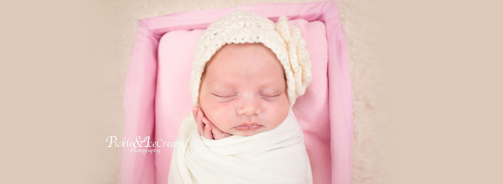 sleeping-baby-girl-pink-basket-min.jpg