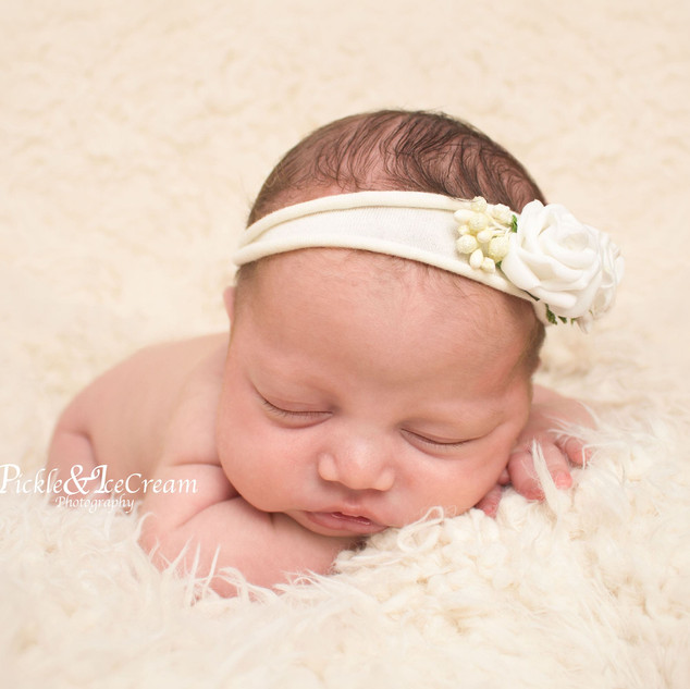 newborn-baby-girl-headband-sleeping.jpg