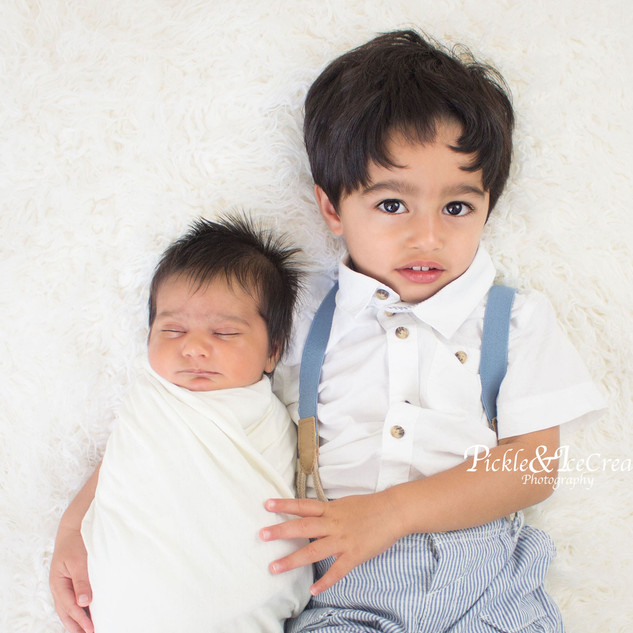 siblings-brothers-swaddle-hugging.jpg
