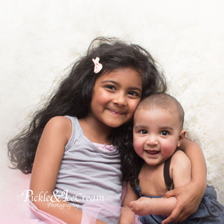 siblings-sister-baby-brother-hugging-tut