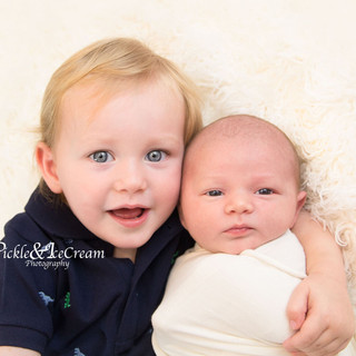 siblings-brothers-hugging-beautiful-blue