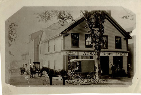 1900's photo of Atsatt Brothers Grocery store with a horse and carriage out front