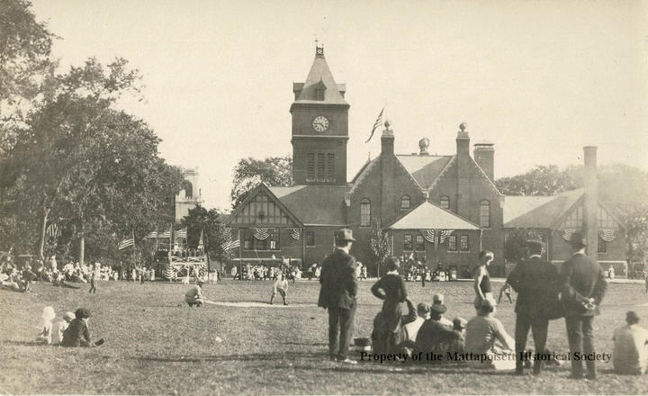 Baseball game being played on the grounds of Center School.