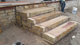 Milsap steps framed in OK chopped stone.