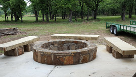 Fire pit with stone benches.jpg