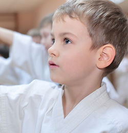 children martial arts puyallup student in line wearing uniform