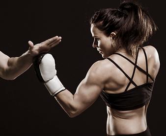 fit women training left upercut