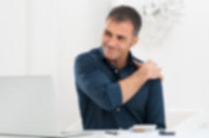 Portrait Of Mature Man At Work Suffering