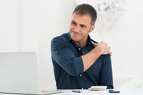 Portrait Of Mature Man At Work Suffering