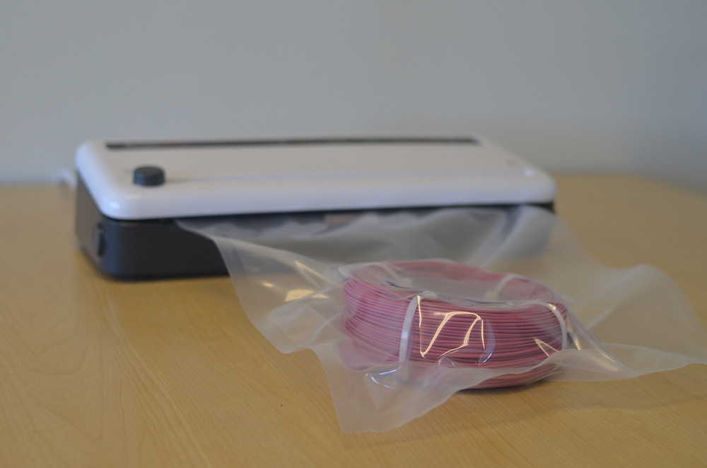 Spool of U-HIPS filament in a vacuum sealer