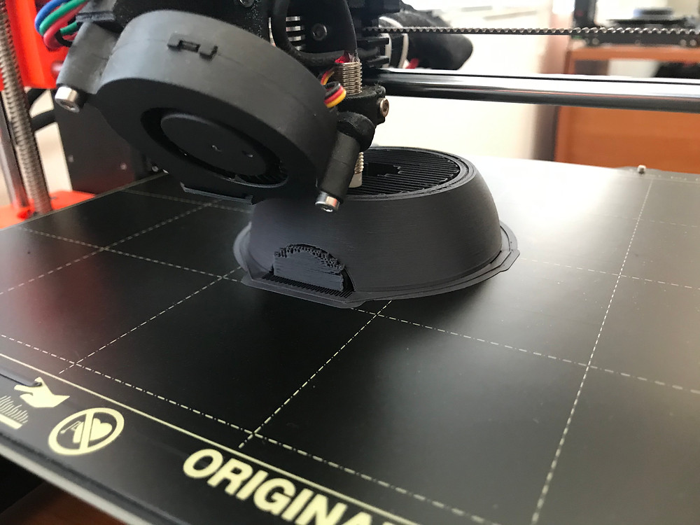 3D printed poke ball with support material in the center cavity