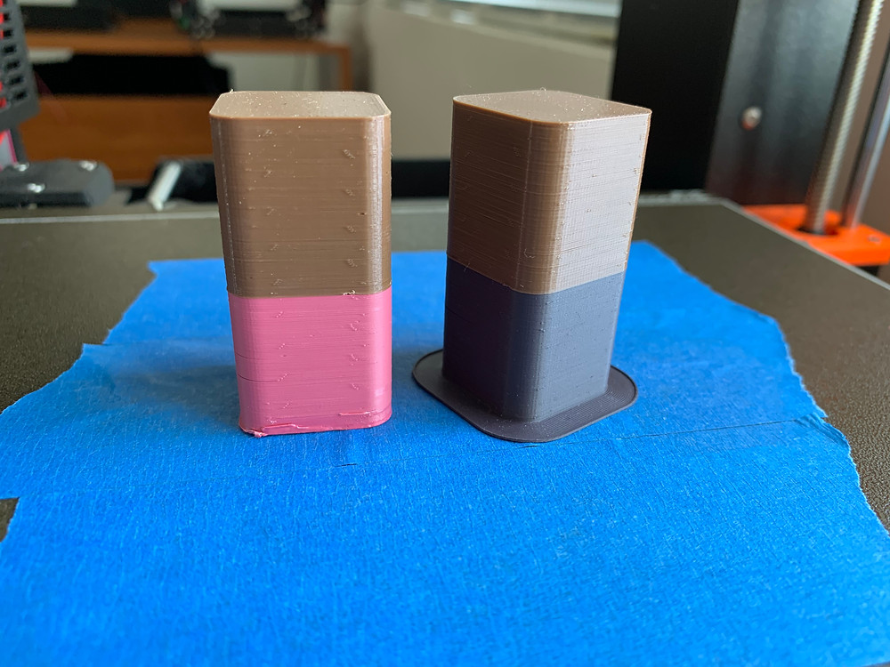 Two 3D printed specimens with brown PLA on top of party pink and black U-HIPS