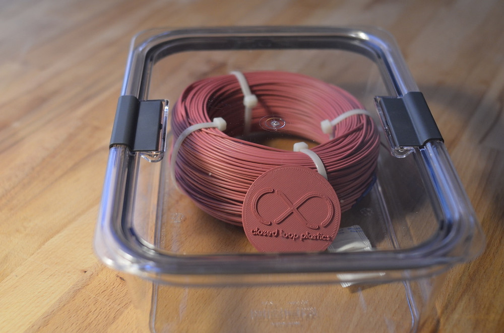 Spool of U-HIPS filament in an airtight container