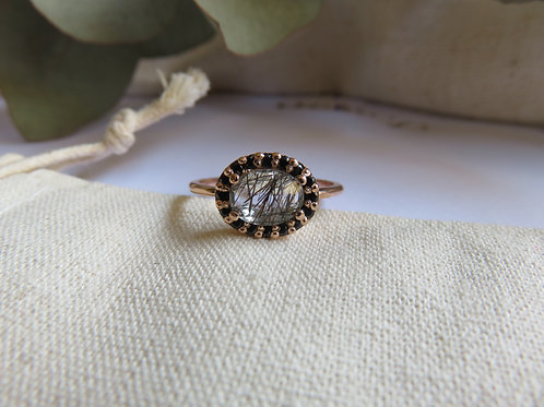 Oval Rutilated Quartz with Black Spinel Halo in 9ct Rose Gold