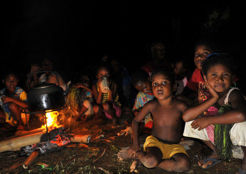 Batek children gathered around the fire. The Batek are a semi-nomadic indigenous group numbering at just over 1,000.