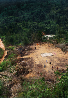 The Temiar Orang Asli of Kelantan endured a long and difficult start in 2015 as unprecedented floods at the end of 2014 eroded access roads to many villages in the interior.  While the flood waters devastated certain areas swiftly and briefly, for many villages in areas hard hit by logging, the hardship was prolonged for months. Kampung Ipes in this photo, prepared a landing zone (LZ) made from woven bamboo to welcome food aid delivered by helicopters sent by NGOs, government departments and efforts by concerned individuals.