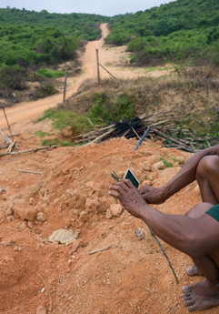 Johari Aluej sits in front of his community's dismantled blockade to stop loggers from logging in their customary land.   2020, Kampung Ong Jangking.
