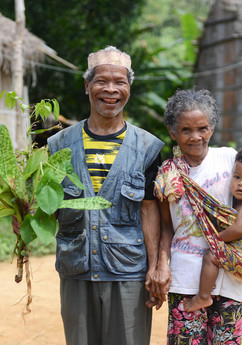 Yok Met, is a Semai Orang Asli from Kampung Tenlan in Pahang, asked if his wife could join in the picture, and so she hopped in shyly with their grandchild while he held on to a bouquet of medicinal plants from the forest.