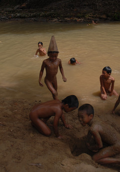 The children used dried leaves by the river and shaped it as a hat to mimic the traditional attire worn by Murut elders during a wedding ritual which they witnessed the night before. 2012, Kampung Alutok, Sabah.