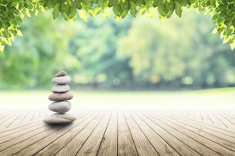 zen stones on empty wooden with green le