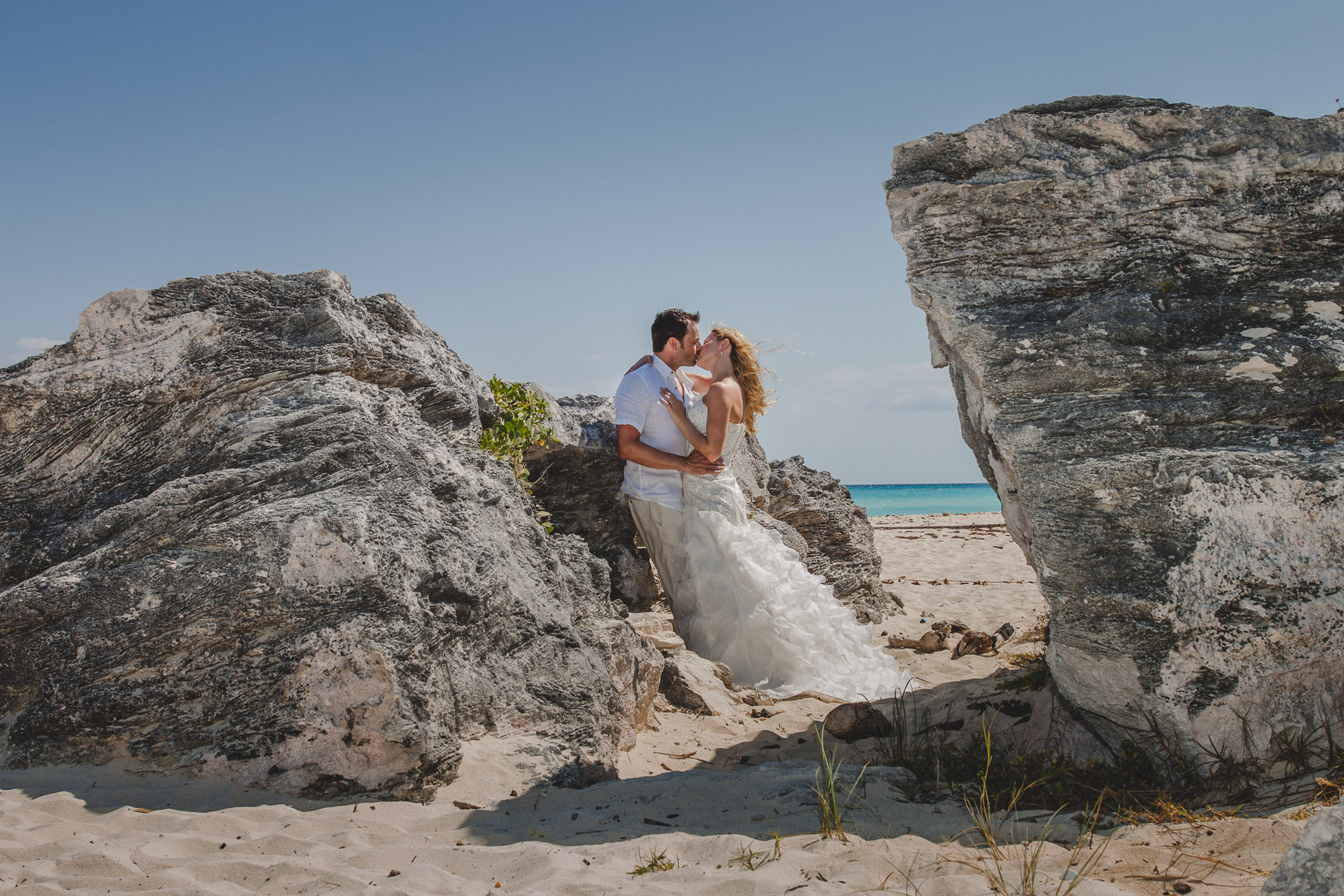 Secluded beach photo session of Bride and Groom
