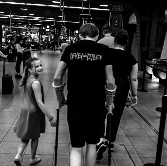 Life is equal to suffering, this t-shirt says.  Brussels Midi Station