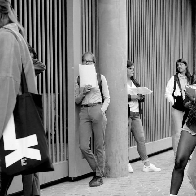 Outside the faculty of architecture in Brussels, just before the exam.  No one wears a mask except for one student who takes his course for a mask.