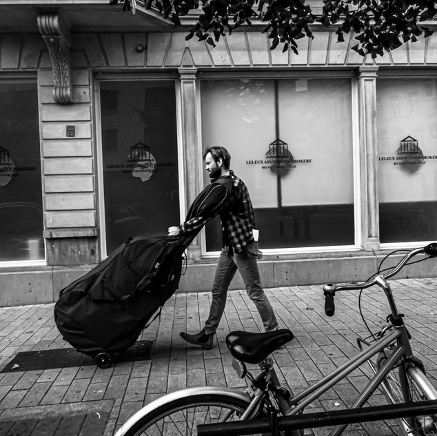 A contrabassist returns home after the last repetition before the first concert in the renewed Music Hall of the Bijloke in Ghent.