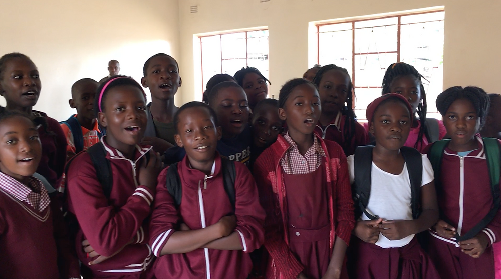 Zambian grade 6 students sing a song from Haiti