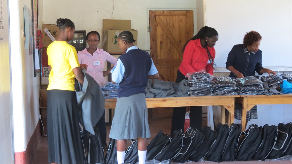 School uniforms are distributed and fitted.