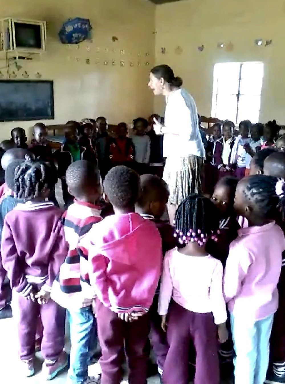 Singing a click song with Zambian pre-schoolers