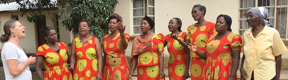Singing a Kenyan praise song with Zambezi doll makers