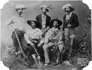 Texas Jack and Buffalo Bill seated with hunting party
