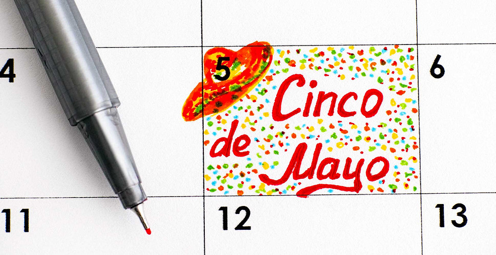 May 5th, Cinco de Mayo, written in bright colors on a calendar, as a reminder to celebrate the Mexican holiday