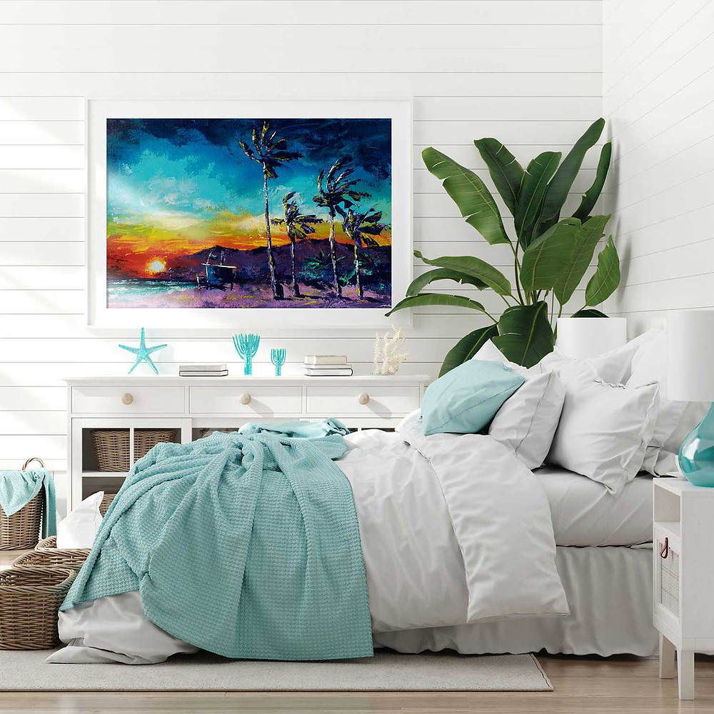 Tropical beach sunset painting beside the bed in an ocean themed bedroom