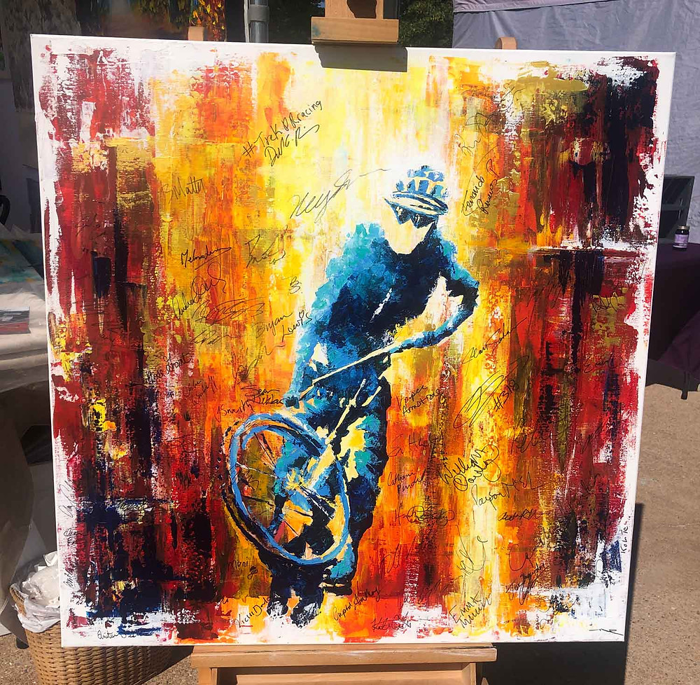 Painting of mountain biker signed by Epic Rides winners, painted by Nelson Ruger