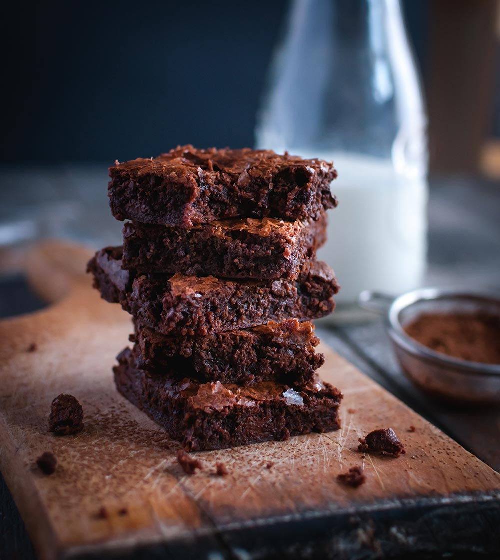 Stack of chocolate Habanero Brownies featuring El Yucateco Black Label Reserve Sauce for tailgating party.